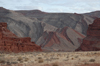 The layered, red and gray cliffs that line the river are a work of art
